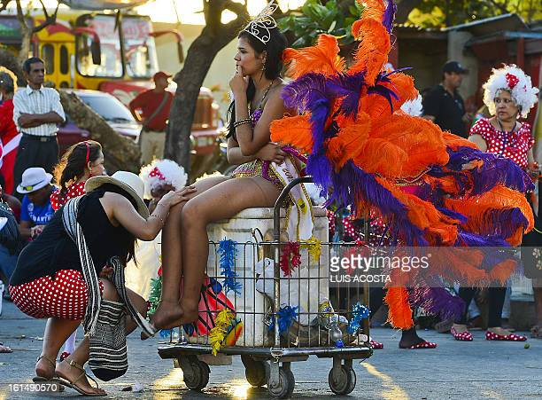 A dancer rests after taking part in the third day of carnival in Barranquilla Colombia on February 11 2013 Barranquilla's Carnival a tradition...