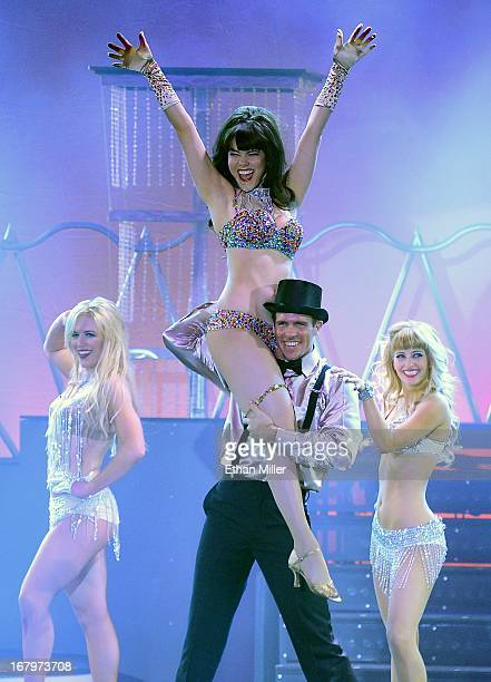 Dancer Sarah Short model Claire Sinclair dancer Ryan Kelsey and singer Anne Martinez perform during the premiere of the show 'Pin Up' at the...