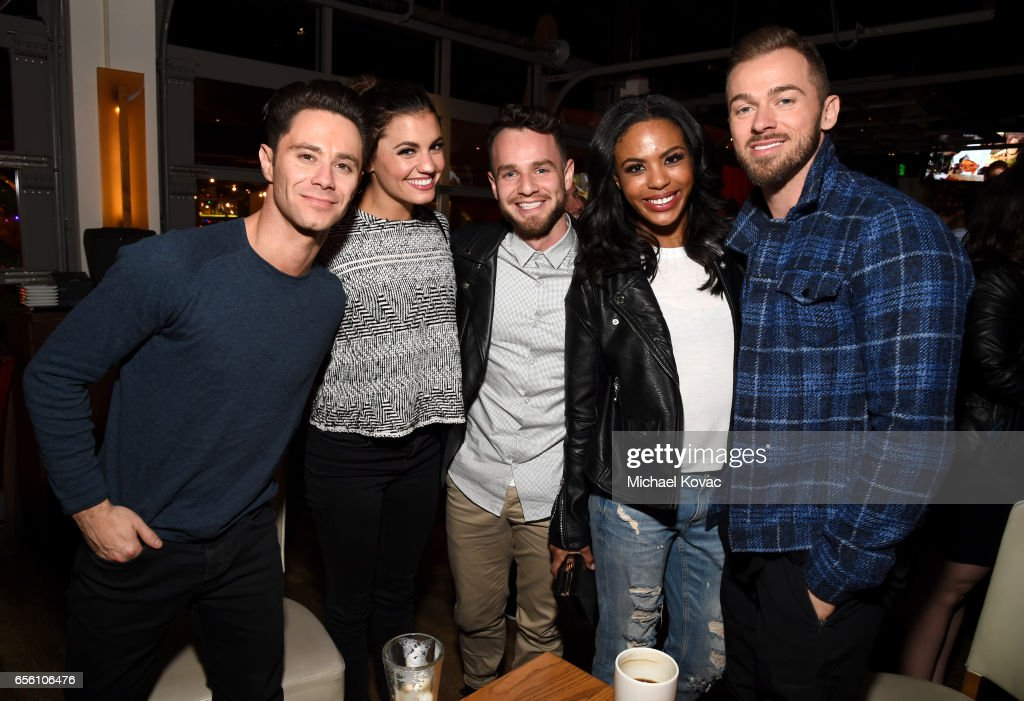 Dancer Sasha Farber (left), Artem Chigvintsev (right) and guests (center) attend the 'Dancing With The Stars' season 24 premiere celebration at Mixology 101 on March 20, 2017 in Los Angeles, California.
