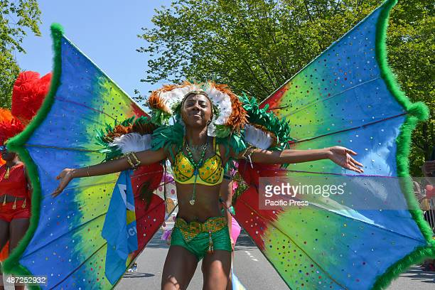 Dancer sports a butterfly-themed costume. Massive crowds gathered along the Eastern Parkway in Crown Heights, Brooklyn to witness the annual West...