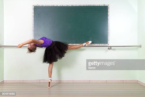 dancer streching at the barre - barre class stock photos and pictures