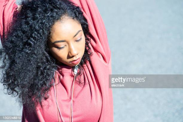 dancer stretching in the park - showus stock pictures, royalty-free photos & images