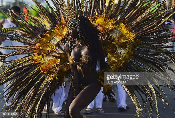 A dancer takes part in the third day of carnival in Barranquilla Colombia on February 11 2013 Barranquilla's Carnival a tradition created by locals...