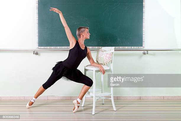 dancer training in a dance studio - barre class stock photos and pictures