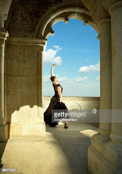dancer under the arch - flamenco stock photos and pictures