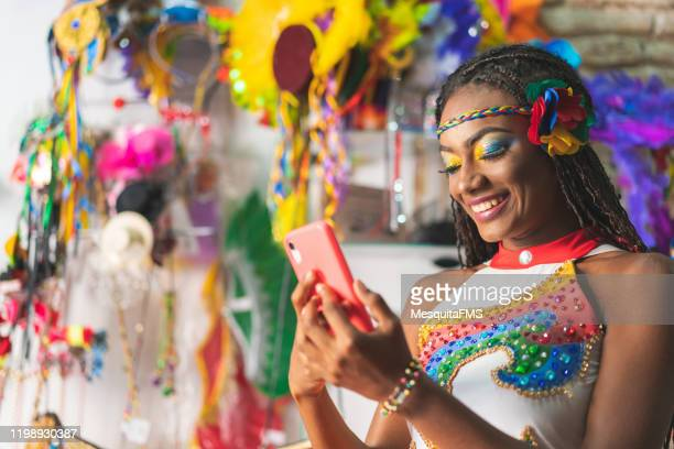 dancer using smart phone - carnival stock pictures, royalty-free photos & images