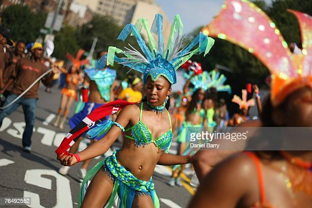 A dancer walks in the West Indian Day Parade September 3 2007 in the Brooklyn borough of New York City The tradition of the parade dates back...