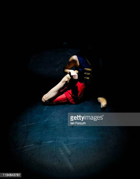 A dancer warms up and stretches on stage minutes before the curtain goes up for the World Premier of Northern Ballet's performance of 'Victoria' at...