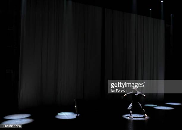 A dancer warms up on stage minutes before the curtain goes up for the World Premier of Northern Ballet's performance of 'Victoria' at Leeds Grand...