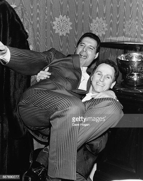 Dancer Wayne Sleep lifting singer Freddie Mercury up in the air at the '42nd Street' party April 14th 1987