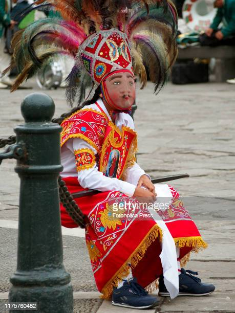 Dancer wearing typical costume when participating in the andean parade in downtown Lima in Honor of the Virgin of the Nativity.