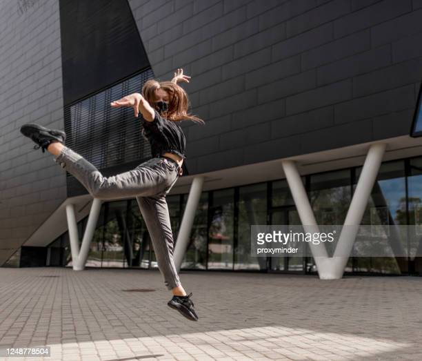 dancer with black face mask outdoors - performing arts event stock pictures, royalty-free photos & images