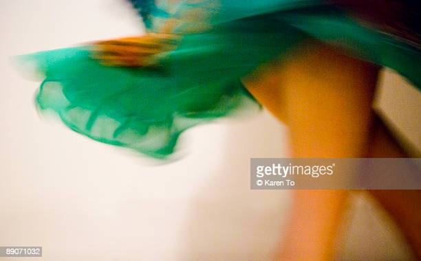 dancer with fluttering skirt - skirt blowing stock photos and pictures