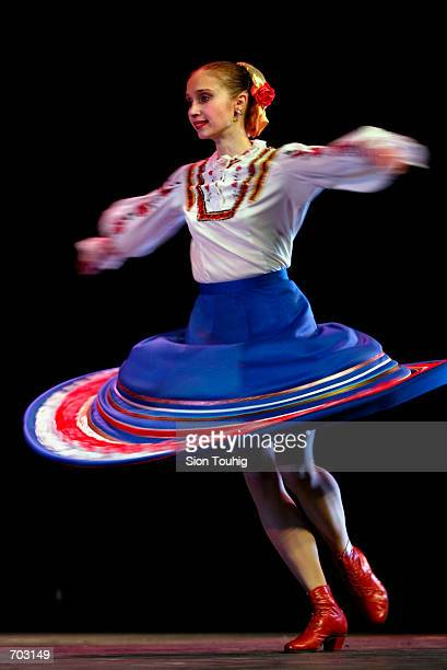 A dancer with the Russian Cossack State Song And Dance Ensemble rehearses February 27 2002 in the Peacock Theatre in London prior to their first...