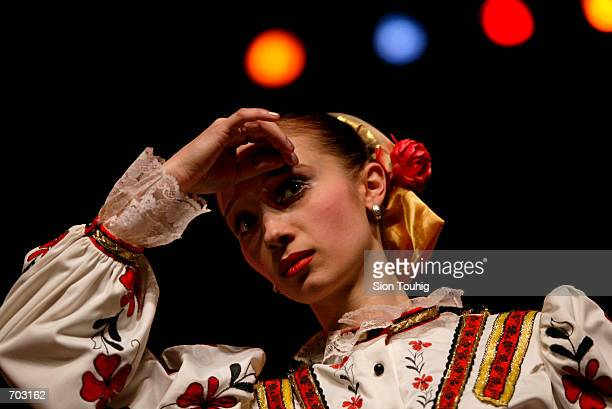 A dancer with the Russian Cossack State Song And Dance Ensemble listens to directions February 27 2002 during rehearsals in the Peacock Theatre in...