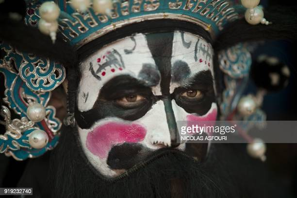 TOPSHOT A dancer with traditional Pekin Opera costume waits to perform at a fair to celebrate the Lunar New Year marking the Year of the Dog at the...