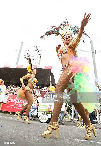 A dancer woman takes part in the traditional 55th Desfile de Silleteros during the Feria De Flores 2012 at Guayaquil Bridge on August 7 2012 in...