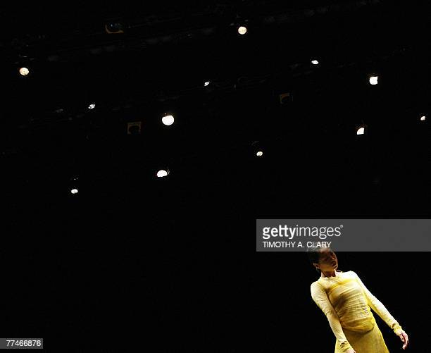 Dancer Yanni Yin with the Ballet Du Grand Theatre De Geneve performs ParaDice during a dress rehearsal before opening night 23 October 2007 at the...