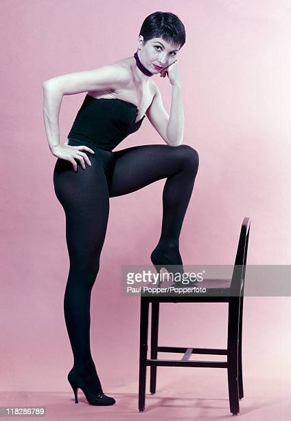 Dancer Zizi Jeanmarie poses with a chair in a studio setting circa 1960