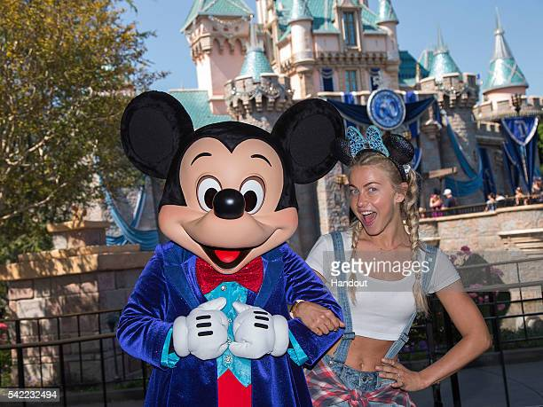 Dancer/Actress Julianne Hough visits Sleeping Beauty Castle with Mickey Mouse at Disneyland park on June 22 2016 in Anaheim California