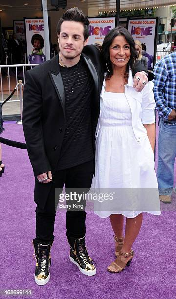 Dancer/choreographer Casper Smart and his mom Shawna Lopaz arrive at Twentieth Century Fox And Dreamworks Animation's 'Home' Premiere at Regency...