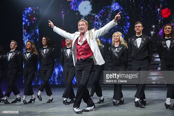 Dancer/choreographer Michael Flatley and company perform on stage during the Lord of the Dance Dangerous Games Broadway opening night at the Lyric...