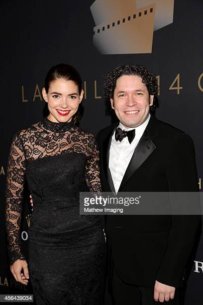 Dancer/journalist Eloisa Knife Maturen and conductor Gustavo Dudamel attend Los Angeles Philharmonic's Walt Disney Concert Hall Opening Night Gala on...