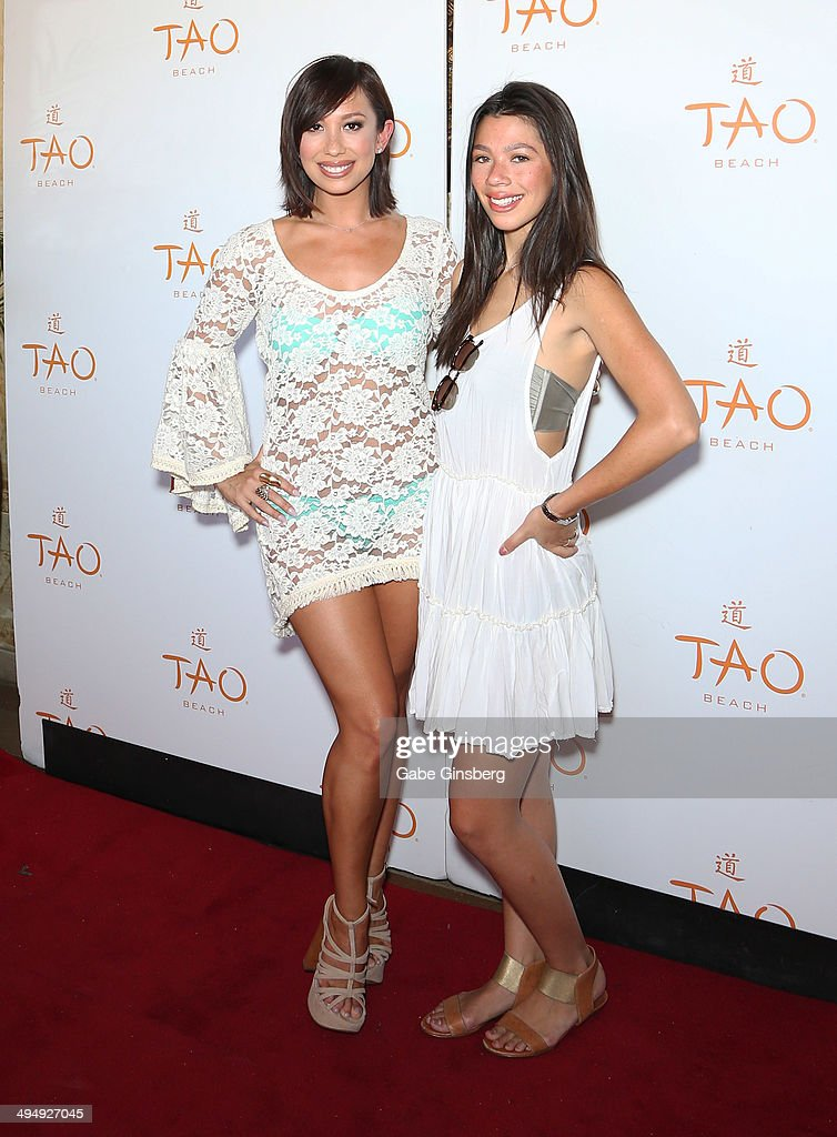 Dancer/model Cheryl Burke (L) and her sister Nicole Burke arrive at a birthday celebration hosted by Cheryl Burke at the Tao Beach at The Venetian Las Vegas on May 31, 2014 in Las Vegas, Nevada.