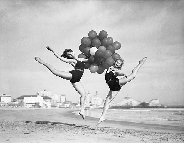 Women Doing Balloon Dance On Beach