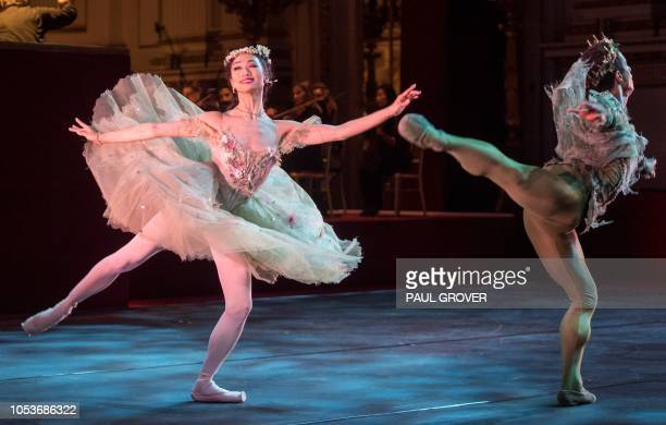 Dancers Akane Takada and Marcelino Sambe perform during a gala concert in the Throne Room at Buckingham Palace in London on October 25 to mark 70th...