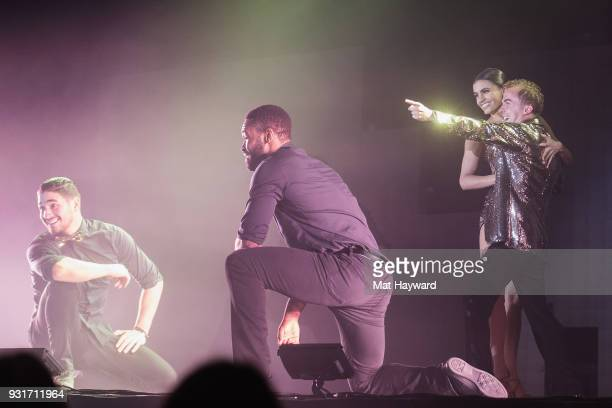 Dancers Alan Bersten Keo Motsepe Hayley Erbert and Frankie Muniz perform on stage during Dancing With The Stars Live at WaMu Theater on March 13 2018...