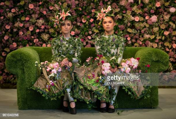 Dancers Alison Parsons and Georgia PatonDurrant pose in a floral display during a photocall on the eve of the Harrogate Spring Flower Show at the...