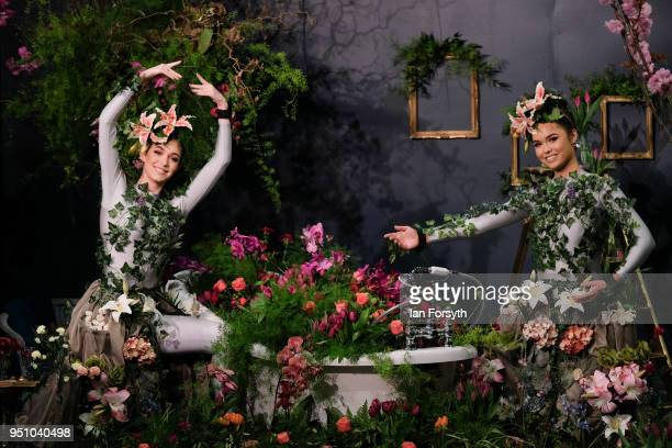 Dancers Alison Parsons and Georgia PatonDurrant pose in a floral display called Greenhouse during staging day for the Harrogate Spring Flower Show on...