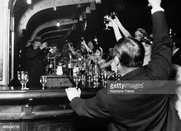 Dancers and clients at the bar of the Moulin Rouge 1929 in Paris France