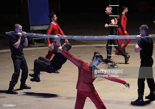Dancers and Monaco's firemen perform on July 2 in Monaco during a rehearsal of the ballet La danse des Sapeurs Pompiers directed by Dutch Krisztina...