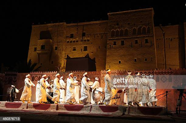 Dancers and musicians perform at Kasbah Taourirt castle during the National Festival of Ahwach Arts held in Ouarzazate Morocco on November 16 2013...