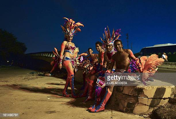 Dancers are seen after taking part in the third day of carnival in Barranquilla Colombia on February 11 2013 Barranquilla's Carnival a tradition...