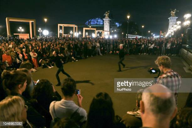 Dancers are seenon the Alexander III Bridge in Paris on october 6 2018 during the Nuit Blanche Each first Saturday in October this event invites to...