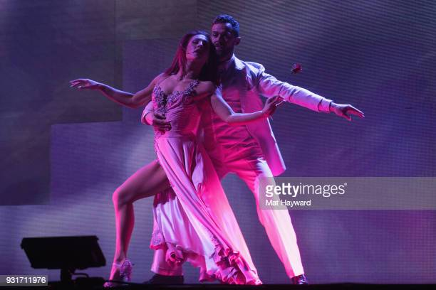 Dancers Artem Chigvintsev and Sharna Burgess perform on stage during Dancing With The Stars Live at WaMu Theater on March 13 2018 in Seattle...