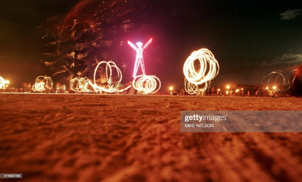 """Dancers at the """"Burning Man"""" festival create patte : News Photo"""