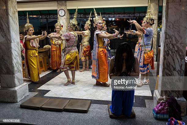 Dancers at the Erawan Shrine preform after a ceremony to commemorate the victims of the Bangkok bomb attack on August 24, 2015 in Bangkok, Thailand....