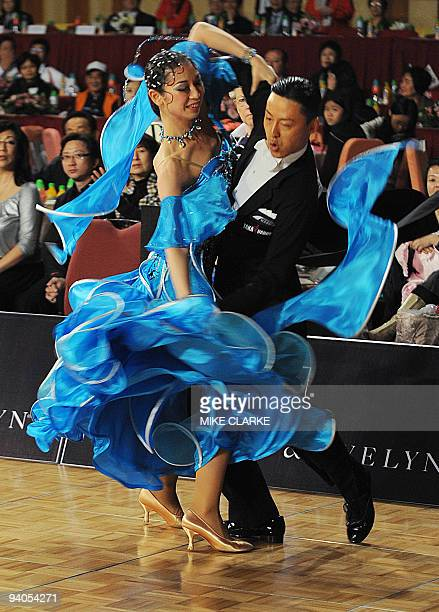 Dancers Ayami Kubo and Masayuki Ishihara perform the quickstep during the dancesport event at the 2009 East Asian Games in Hong Kong on December 6...