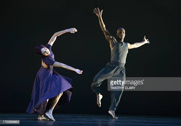 Dancers Belen Pereyra and Glenn Allen Sims of the Alvin Ailey American Dance Theater perform part of 'Four Corners' during a dress rehearsal June 12...