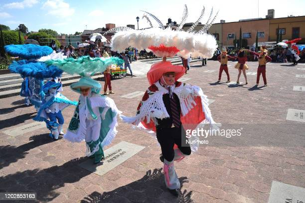 Dancers called Huehues take part during the traditional Carnival of Tlaxcala disguised in traditional costumes of the region and wooden masks...