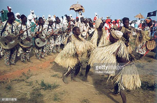 Dancers celebrate the Queen of England's visit to Nigeria during Durbar celebration Durbar is a traditional dance and parade featuring the...