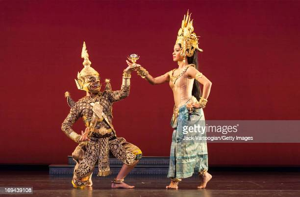Dancers Chhorn Niboran and Chap Chamroeuntola both of the Royal Ballet of Cambodia perform in 'The Churning of the Sea of Milk' as part of the...