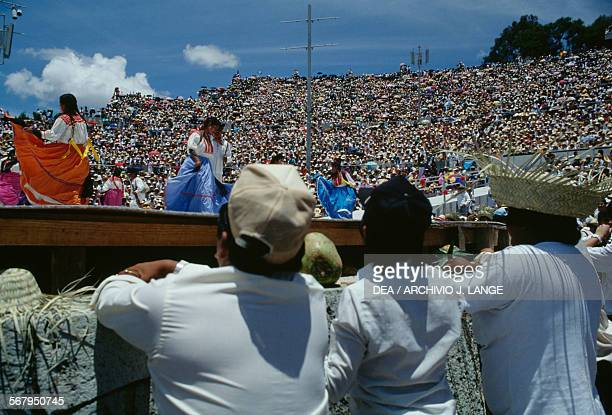 Dancers dancing in traditional costumes during the celebrations at the Guelaguetza festival Oaxaca Mexico