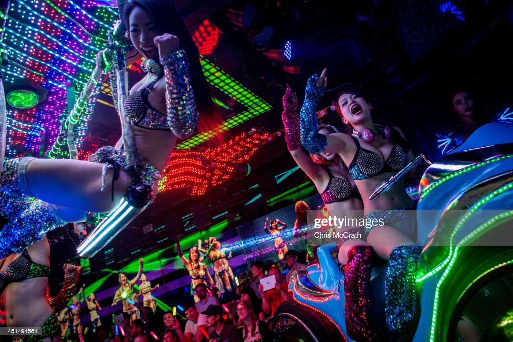 Dancers dressed as futuristic characters perform during a show at The Robot Restaurant on June 29, 2014 in Tokyo, Japan. The now famous Robot Restaurant opened two years ago in Kabukicho area of Shinjuku at an estimated cost of 10 million U.S. dollars. Performances are held three times a day and cater mostly to foreign tourists. The cabaret style shows include bikini clad futuristic dancers, performers dressed as robots and a host of large scale robots and vehicles controlled with remotes by stage hands dressed as Ninjas