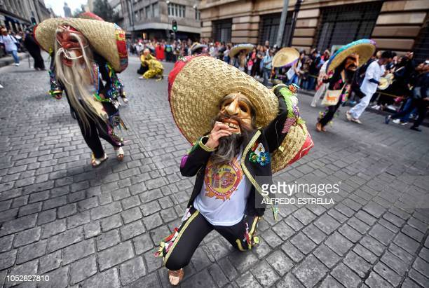Dancers dressed in traditional costumes take part in the tenth Monumental Alebrijes Parade and contest organized by the Folk Art Museum on October 20...