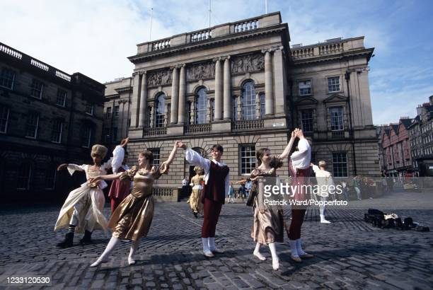 """Dancers during a performance of """"Cinderella"""" in Parliament Square during the Edinburgh Festival in Scotland, circa September 1998."""